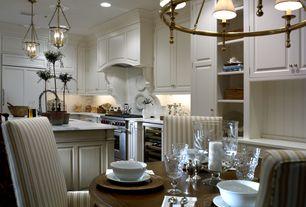 Traditional Dining Room with Wainscotting, flush light, Laminate floors, Built-in bookshelf