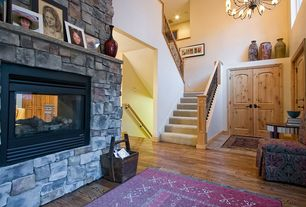 Craftsman Entryway with Chandelier, stone fireplace, High ceiling, Hardwood floors
