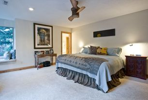 Traditional Master Bedroom with Ceiling fan, Window seat, Carpet