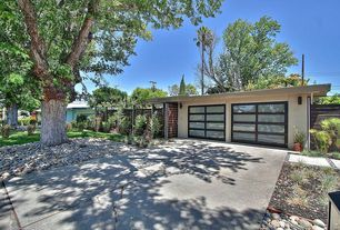 Modern Garage with specialty door, Concrete tile , Concrete floors, Wall sconce, Standard height