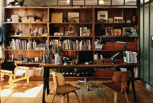 Contemporary Home Office with Hardwood floors, Herman miller - eames desk chair, Vitra - eames house bird, Frosted glass door
