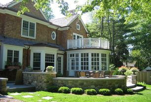 Traditional Landscape/Yard with exterior stone floors, Fence, Deck Railing, double-hung window, French doors, Pathway