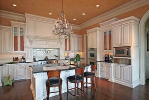 Traditional Kitchen with built-in microwave, Breakfast bar, Raised panel, Wall Hood, double wall oven, Kitchen island
