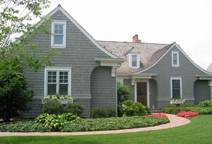 Traditional Exterior of Home with Grass, Paint 1, shingle siding, Lawn, double-hung window, Brick pathway