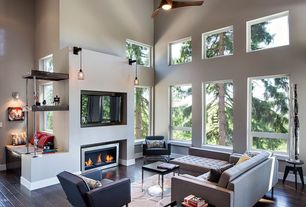 Contemporary Great Room with Electric fireplace, Bent plywood breakfast table, Dark hardwood floors