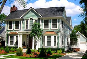 Traditional Exterior of Home with Arched window, Pitch roof line, Fence, Bay window, Pathway, Columns
