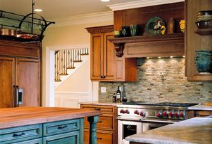 Traditional Kitchen with Wood counters, U-shaped, Custom hood, can lights, Standard height, double oven range, Stone Tile