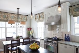 Traditional Kitchen with Crown molding, One-wall, Pendant light, Flat panel cabinets, Wood counters, Breakfast nook
