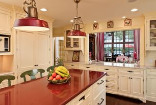 Country Kitchen with Dupont - Zodiac Indus Red Quartz, KitchenCraft Cabinetry - Coventry in Thermofoil