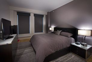 Contemporary Guest Bedroom with Euro platform bed and headboard, Laminate floors, interior wallpaper