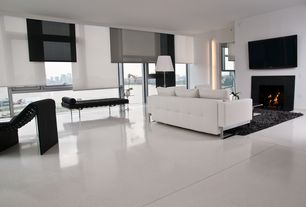 Contemporary Living Room with simple marble tile floors, Crown molding, Studio Leather Sofa