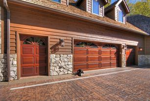 Traditional Garage with Wall sconce, Exterior stone wall, Brick floors