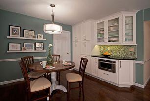 Modern Dining Room with Built-in bookshelf, Chair rail, Hardwood floors, flush light