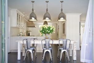 Contemporary Dining Room with Restoration Hardware - Remy Side Chair, Laminate floors, Pendant light, Built-in bookshelf