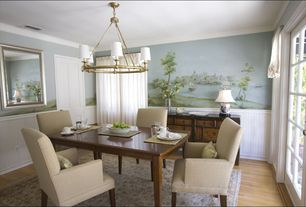 Traditional Dining Room with Glass panel door, Wainscotting, Williams sonoma home devon chandelier, Laminate floors, Paint 1