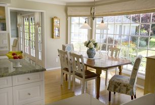 Traditional Dining Room with Crown molding, Laminate floors, Pendant light