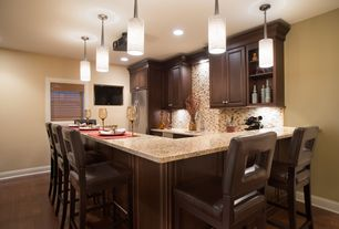 Contemporary Kitchen with MS International Giallo Fantasia Granite, Pendant light, Simple granite counters, Galley