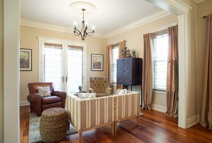 Traditional Living Room with Hardwood floors, Chandelier, Crown molding, French doors