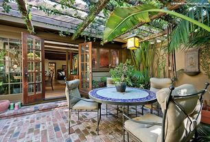 Eclectic Patio with double-hung window, Trellis, French doors, Glass panel door, picture window, Paint, exterior brick floors