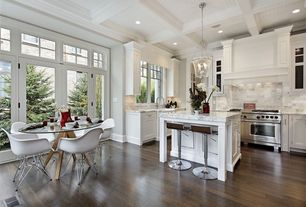 Contemporary Kitchen with Crown molding, full backsplash, Breakfast bar, Custom hood, Pendant light, Transom window, Casement