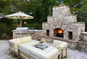 Contemporary Patio with Outdoor kitchen, stone fireplace, Coral Coast Key Largo 9-ft. Wood Market Umbrella, Fence