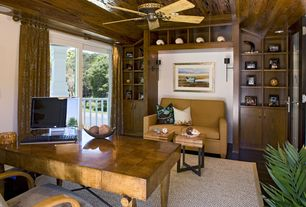 Craftsman Home Office with Built-in bookshelf, Ceiling fan, French doors, Hardwood floors