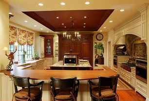 Traditional Kitchen with Flat panel cabinets, Built-in bookshelf, Heirloom wood countertops, can lights, Custom hood, Paint