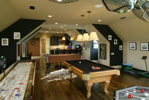 Traditional Game Room with Pendant light, Laminate floors, High ceiling