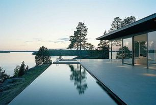 Contemporary Swimming Pool with Exterior sliding doors, Washed concrete