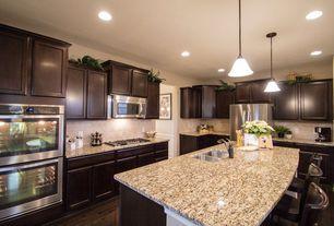 Traditional Kitchen with Raised panel, Simple granite counters, Stonemark Granite-ranite Countertop in St. Cecilia Classic
