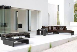 Contemporary Patio with Fence, folding door, picture window, exterior concrete tile floors