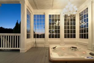 Traditional Hot Tub with Exterior paint, privacy wall, Outdoor chandelier, Vintage lightning rod, Wood decking