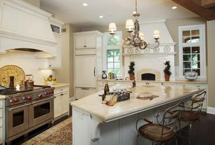 Traditional Kitchen with Casement, Chandelier, double oven range, can lights, Undermount sink, Standard height, Custom hood