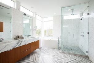 Contemporary Master Bathroom with European Cabinets, herringbone tile floors, Complex marble counters, Undermount sink, Flush