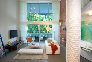 Contemporary Living Room with Poured concrete floors, Fashion N You Butterfly Chair, Columns, Balcony, Chandelier