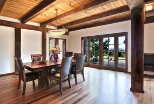Traditional Dining Room with Fireplace, French doors, Exposed beam, picture window, Standard height, insert fireplace