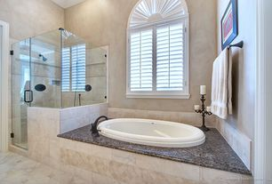 Traditional Master Bathroom with Oval drop in bathtub, Oil rubbed bronze luxury shower system, Paint, Drop in oval bathtub