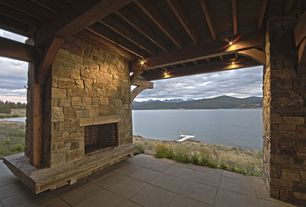 Craftsman Patio with Exposed beam, Covered patio, Stacked stone fireplace