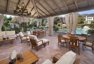 Mediterranean Patio with Restoration Hardware Devon Lounge Chair, Pottery Barn Hampstead Teak Round Drop-Leaf Dining Table