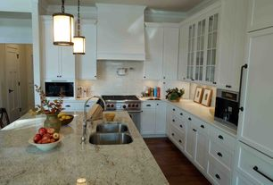 Traditional Kitchen with Subway Tile, Crown molding, Undermount sink, Framed Partial Panel, wall oven, can lights, gas range
