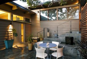 Contemporary Patio with Pond, Transom window, exterior tile floors