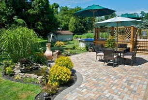 Traditional Patio with Outdoor seating area, Gate, Pathway, exterior brick floors, Above-ground pool, Pond, Chiminea