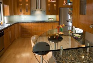 Contemporary Kitchen with Flush, Simple granite counters, Glass Tile, Built In Refrigerator, Wall Hood, Pendant light