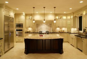 Traditional Kitchen with Pendant light, Undermount sink, Raised panel, Kitchen island, Glass panel, Simple granite counters