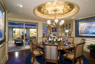 Traditional Dining Room with picture window, can lights, Standard height, interior wallpaper, Laminate floors, Crown molding