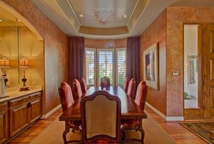 Traditional Dining Room with interior wallpaper, can lights, Standard height, Laminate floors, Bay window