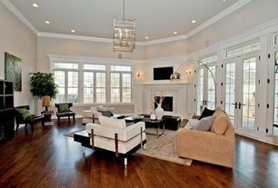 Contemporary Living Room with Troy lighting morgan 8 light entry foyer pendant, Crown molding, stone fireplace, French doors