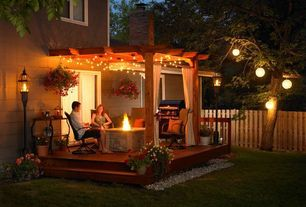 Traditional Patio with Wood pergola, Outdoor kitchen, Trellis, sliding glass door, Fire pit, Casement, Fence