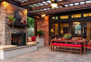 Traditional Patio with sliding glass door, Wood pergola, picture window, exterior concrete tile floors, Brick wall, Trellis