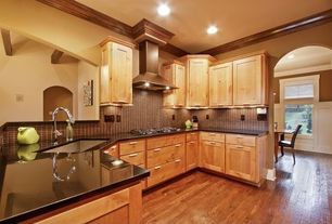 Traditional Kitchen with Crown molding, Large Ceramic Tile, U-shaped, Undermount sink, Simple granite counters